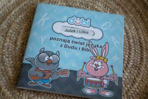 """audiobooki dla dzieci; zdjęcie płyty """"Poznaję świat języka z Dudu i Bibi"""""""